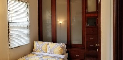 Private bedroom with lighted closet space, LED TV and bathroom.