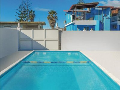Photo for Blue apartment with shared pool