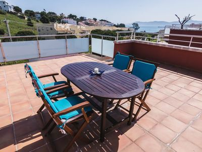 Photo for Charming and bright penthouse with wonderful views of the sea and the coast. It consists o