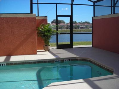 Screened lanai with heated private pool overlooking the lake.