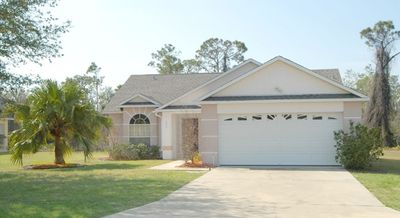 Large lot with front and rear lawns.