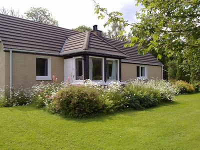 Photo for Cottage With Mountain Views Situated In A 3 Acre Woodland Garden