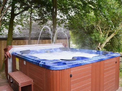 Large Hot Tub which seats 8.  Also outside TV