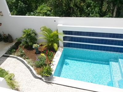 Sunny pool with garden opening to Casa Sunshine