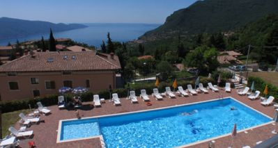Photo for Rent a modern apartment with pool and beautiful lake view on Lake Garda
