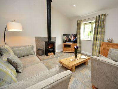 Lovely lounge with wood burner