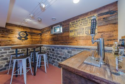 """Relax in the """"Tap Haus"""" and enjoy access to your choice of two local craft beers"""