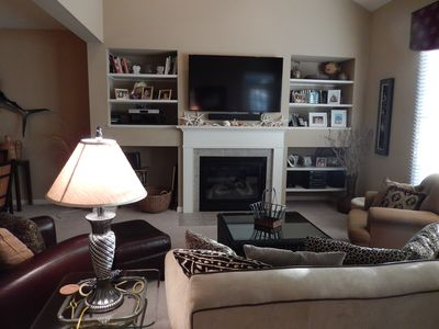 Living Room with flat screen TV, fireplace and screen porch access