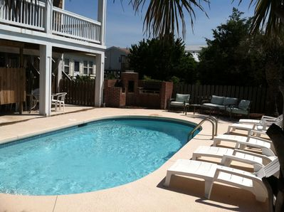 Private heated pool in back. 2 enclosed outdoor showers, 1/2 bath off patio.