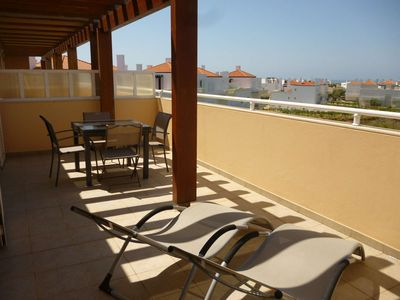 Photo for Apartment on top floor, with swimmingpool and great terrace with sea view