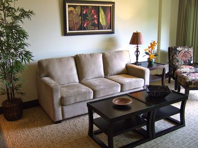 Relax in a comfortable living area. Sofa converts to a queen-sized sleeper.