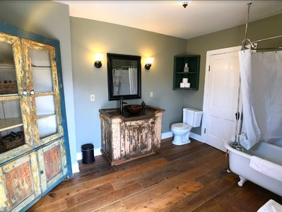 Full bath, full of antiques; complete with a Clawfoot Tub.