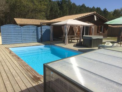 Photo for Near Soulac / sea individual chalet, swimming pool, covered heated to 28 °, jacuzzi