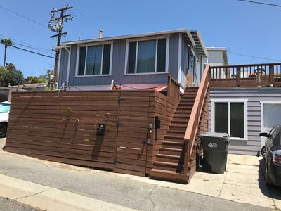 Photo for Unit with a huge deck located 2 blocks to the beach