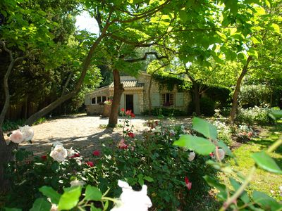Photo for A lush garden near one of the most beautiful villages of Provence