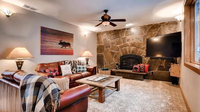 Comfortable and bright living room with plenty of natural lighting along with mounted flatscreen TV.