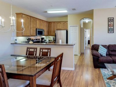 Photo for Dog-friendly condo w/ shared pool, gym, tennis, & game room - close to Disney!