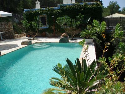 Photo for Typical ibizan stone A/C country villa, with swimming pool facing sunset.