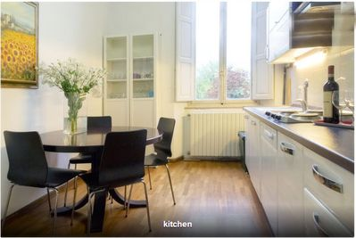 Kitchen with seating for 4 people, washing machine, oven, new electric hob etc