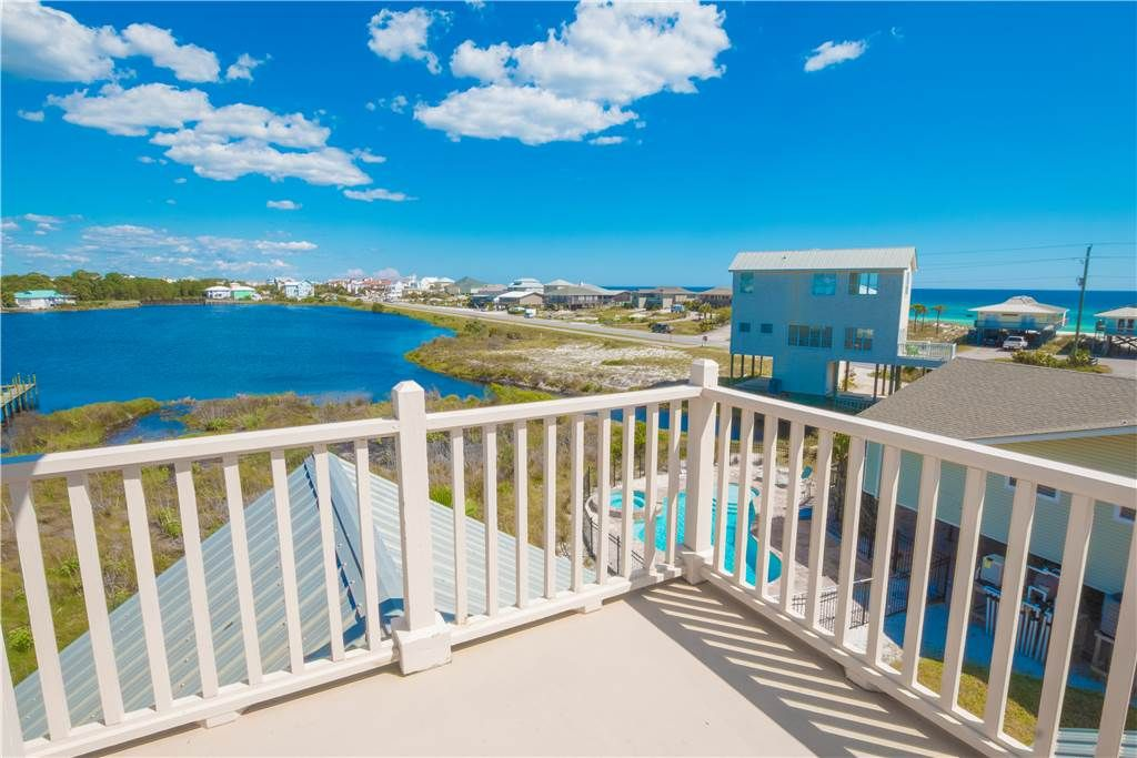 Three story beach home with porch and private pool for Three story beach house