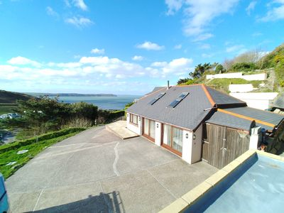 Photo for Quiet Retreat tucked away and close to beach with fantastic views of bay.