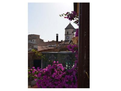 Photo for In front of the terrace Capoliveri, very quaint and cozy