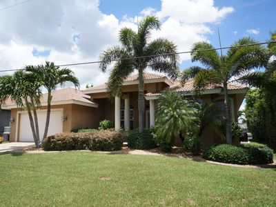 Photo for Alicia 1014 - SE Cape Coral Luxury Electric Heated Pool/Spa Home, walking distance to Cape Coral Bea