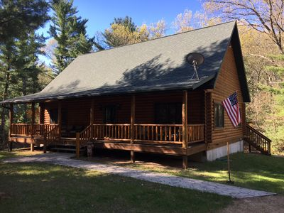 Photo for Cozy log cabin on 3.17 acre wooded lot, minutes from Lake Petenwell!