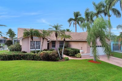 Picture perfect palm trees and professionally landscaped greenery.