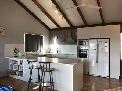Newly renovated kitchen with dishwasher & ample cupboard & bench space.