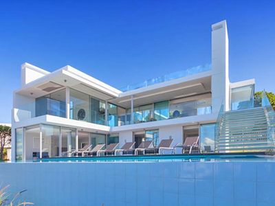 Photo for Fabulous villa with stunning sea views overlooking Garrao beach in Vale do Lobo J116