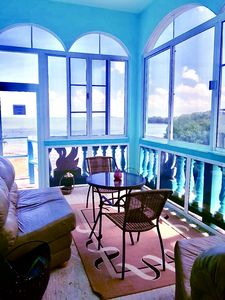 Photo for See Belize SEA VIEW SUNROOM Apt. w/ SWIMMING POOL, OVERWATER DECK & ROOF TERRACE