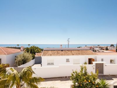 Photo for 3 bedroom Villa, sleeps 6 with Air Con, WiFi and Walk to Beach & Shops
