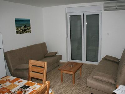 Photo for Two bedroom apartment with terrace Vrboska, Hvar (A-13904-a)