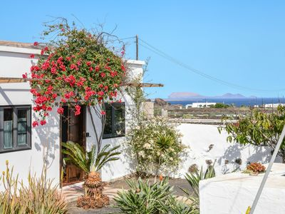 """Photo for Holiday Home """"Casa Abuelo Rafa"""" with Sea View, Mountain View, Wi-Fi, Garden & Terrace; Parking Available"""