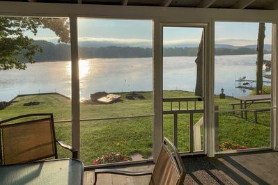 Enjoy sweeping lake views from the screened porch.