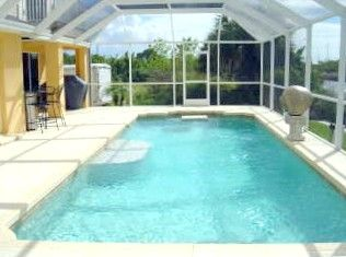BEAUTIFUL 36 FOOT HEATED POOL WITH SUNPAD, BENCH SEAT AND TABLE