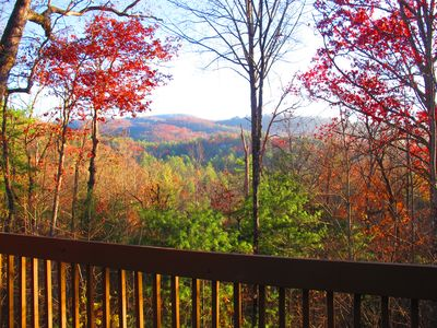 Balcony view during leaf-changing fall season.