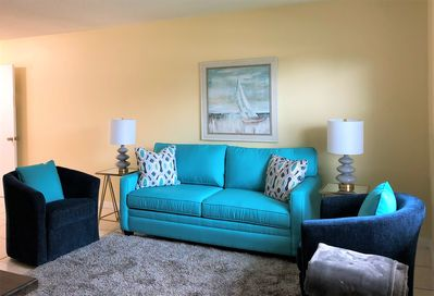 New furniture in bright beach colors create a comfortable and relaxing room.