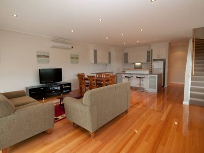 Photo for A Stylish three-level town house close to town and the beach