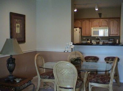 Newly renovated kitchen and bathroom with granite countertops and wood cabinets.