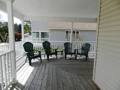 Front Porch wraps to screened porch and rear deck