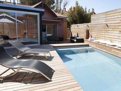 Photo for Wooden house, air conditioned, with swimming pool, located 50 m from the beach