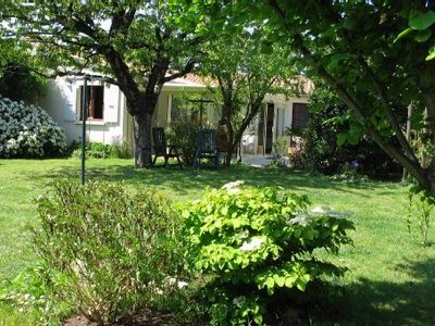 Photo for House in two parts in beautiful enclosed garden in the heart of the Ile de Re