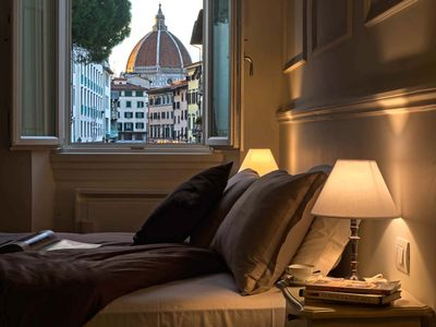 Deluxe suite with great view! Bed and view in the heart of Florence.
