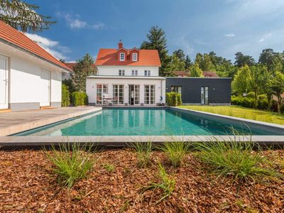 Photo for House Idyll in Putbus | up to 12 pers., Fireplace, Garden, Pool - House Idyll