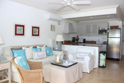 Open plan kitchen and living area, air conditioned and ceiling fan