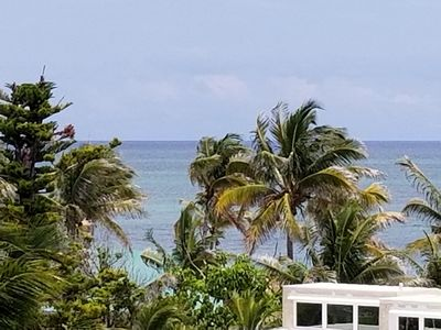 Photo for Beautiful Beach Front One Bedroom Condo with Ocean View and Pool on Coral Beach!