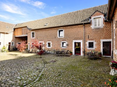 Photo for Nice apartments in a monumental square farm.