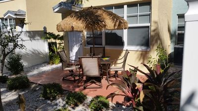 Photo for Enjoy dining on our private patio outside of updated ground floor unit.